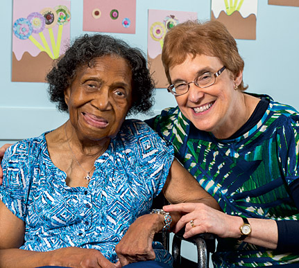 Occupational therapist Sheila Selznick (left) assists longtime client Mary Francis Mathiews at Circle Center Adult Day Services